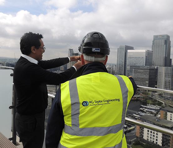 Man on Balcony Over Canary Wharf